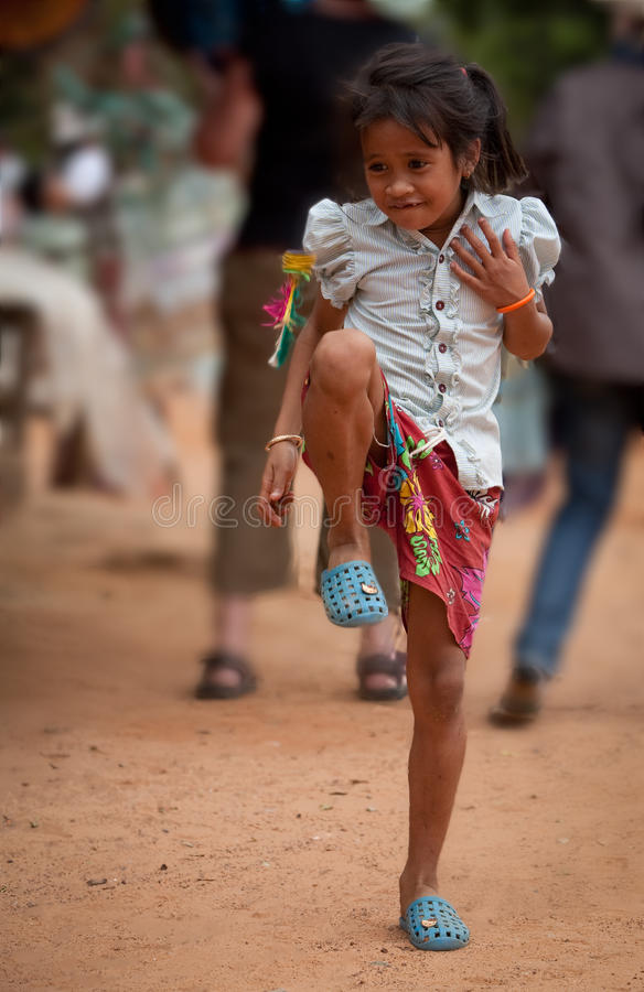 Cambodian girl plays Jiànzi at market Angkor Wat royalty free stock photo