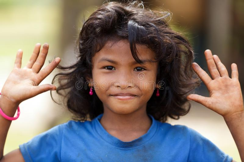 Happy Cambodian Little Girl Using Laptop On A Schoolyard