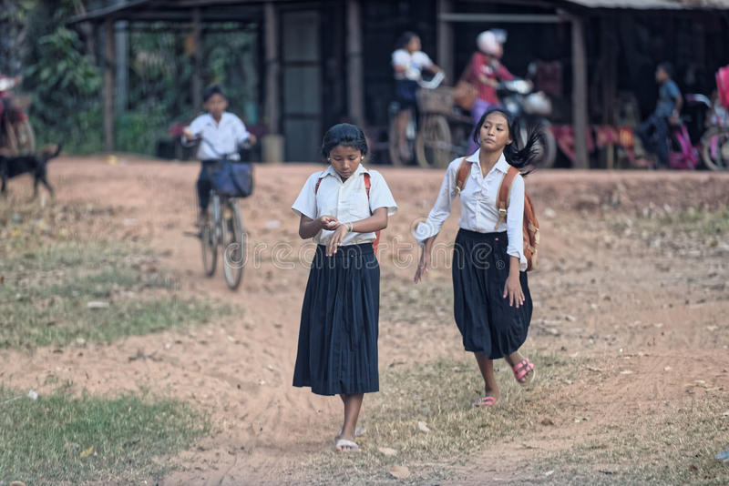 Cambodian school girls. In uniform near temple in Bakong, Cambodia royalty free stock photography