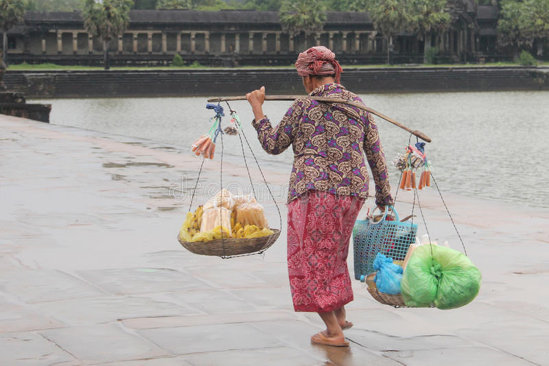 Cambodian woman carrying weights royalty free stock photo