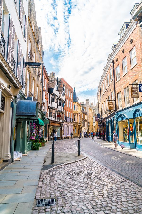 Cambridge, UK - AUG 28 2019: Old Trinity street in Cambridge, UK. It's a university city and the county town of Cambridgeshire,. England royalty free stock photography