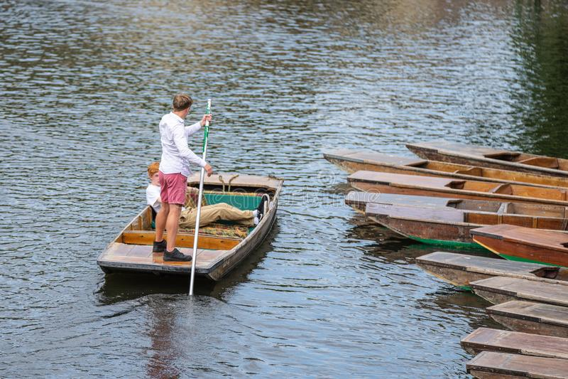 Cambridge, UK, August 1, 2019. The punter pushes a pole against the river bed and this gives the punt a way to move.  stock image