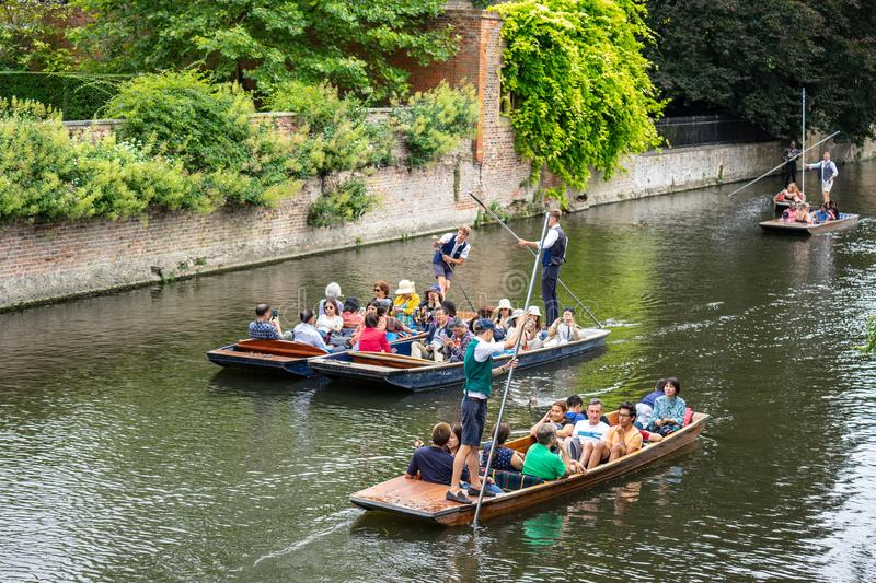 Cambridge, UK, August 1, 2019. The punter pushes a pole against the river bed and this gives the punt a way to move.  royalty free stock image