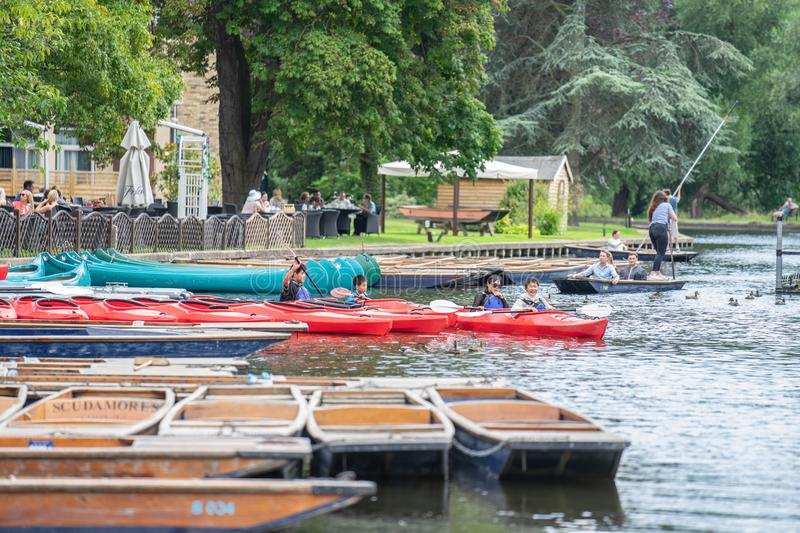 Cambridge, UK, August 1, 2019. The punter pushes a pole against the river bed and this gives the punt a way to move.  royalty free stock photos