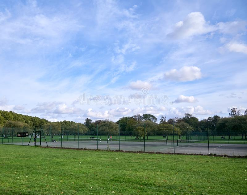 Cambridge, UK - October 9, 2019: tennis court in the city. Cambridge, UK - October 9 2019. Tennis court i the city, ball, game, sport, racket, match, athlete royalty free stock photography