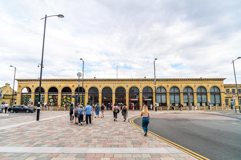 Cambridge, United Kingdom. 28 AUG 2019 : Cambridge Railway station. Passengers are seen arriving at the station and walking to the. Entrance royalty free stock photography
