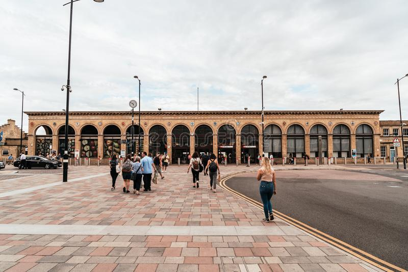 Cambridge, United Kingdom. 28 AUG 2019 : Cambridge Railway station. Passengers are seen arriving at the station and walking to the. Entrance royalty free stock photos