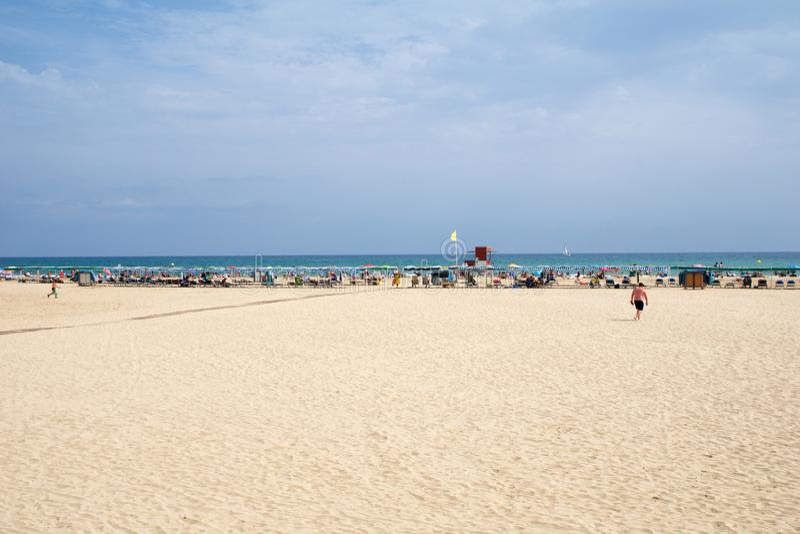 CAMBRILS, SPAIN - AUG 27th, 2017: Sandy beach on the Costa Daurada in the province of Tarragona, Catalonia stock image
