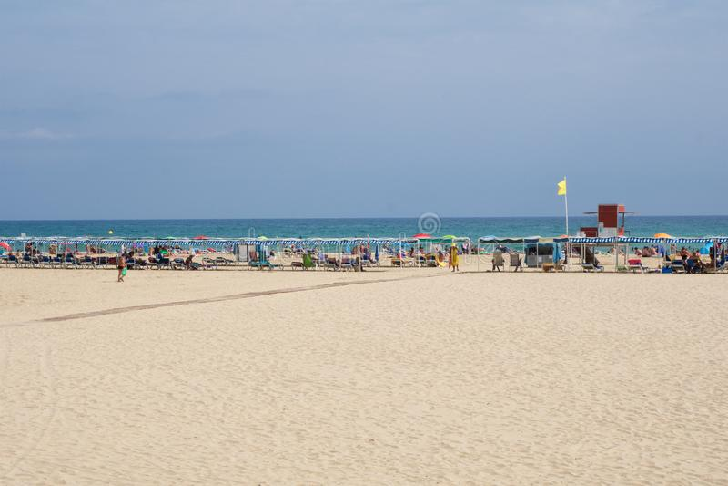 CAMBRILS, SPAIN - AUG 27th, 2017: Sandy beach on the Costa Daurada in the province of Tarragona, Catalonia stock photography