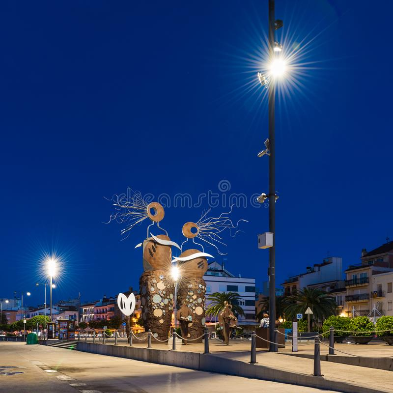 CAMBRILS, SPAIN - SEPTEMBER 16, 2017: View of the embankment of the city and the modern sculpture `The Mermaids`. C royalty free stock image