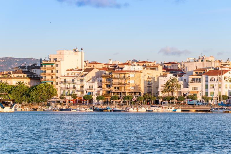 CAMBRILS, SPAIN - SEPTEMBER 16, 2017: View of port and museu d`Hist`ria de Cambrils - Torre del Port. Copy space for text royalty free stock photography