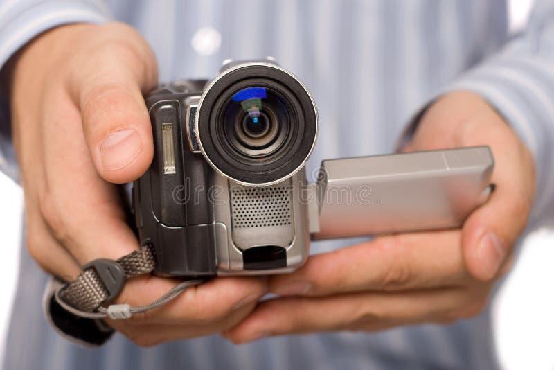 Camcoder de MiniDV en manos del hombre imágenes de archivo libres de regalías