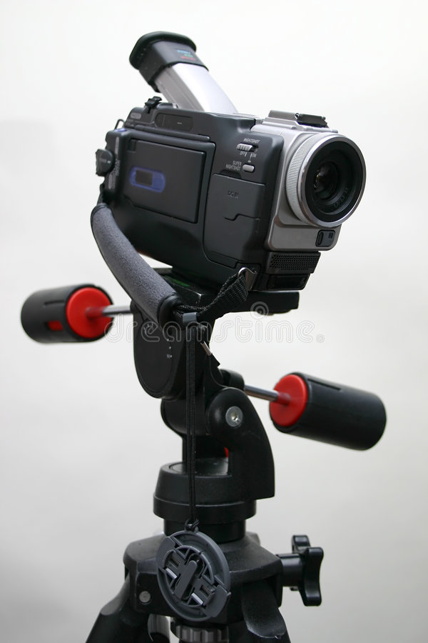 Camcorder on the tripod royalty free stock photo