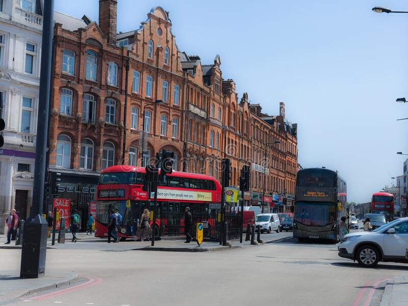 London, United Kingdom- June 2019: Camden Square near Camden High Street with People and  Red Double Decker Buses. Camden Square near Camden High Street with stock photos
