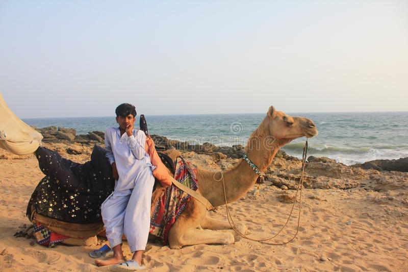 Download Camel and boy by the Sea editorial stock image. Image of middle - 24363099