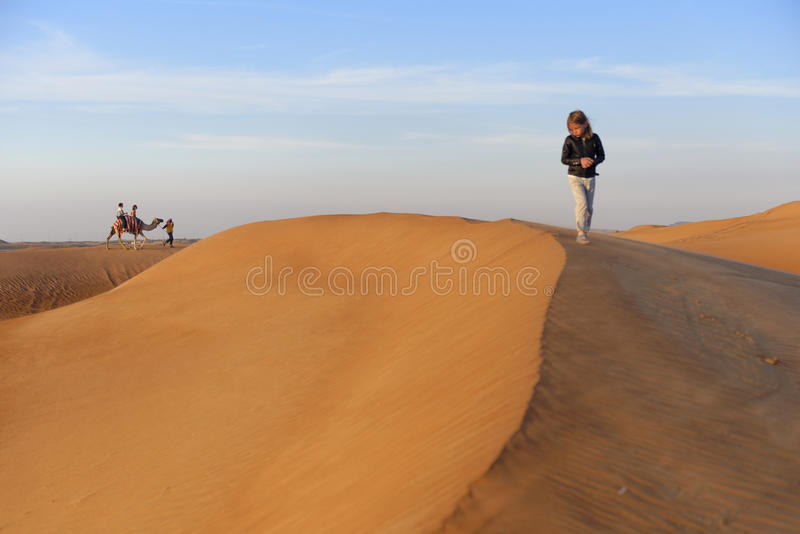 Camel ride in the desert royalty free stock images