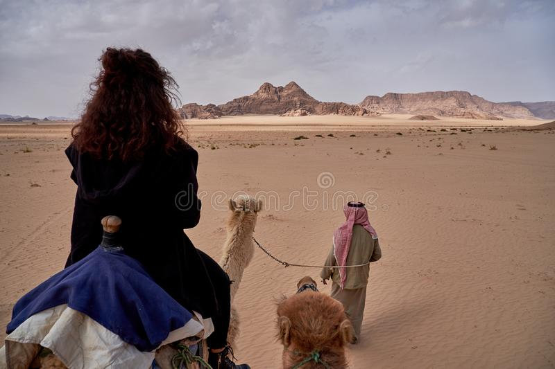 Camel ride in Wadi Rum desert in Jordan. POV, space for text stock photo