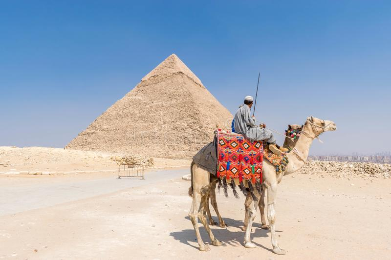 Camel Riders and Pyramid of Khafre stock image