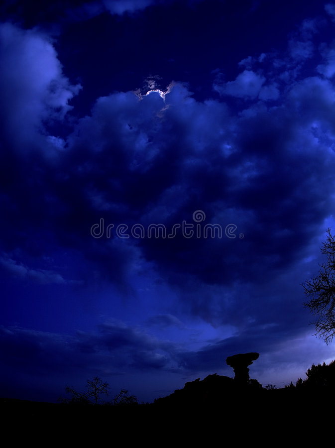Camel Rock at night. Camel Rock with moon behind the clouds royalty free stock photos