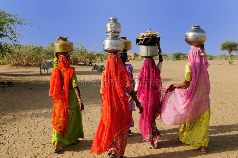 Camel Safari. Thar desert near Jaisamler. Ethnic women going for the water in well on the desert. Rajasthan, India royalty free stock image