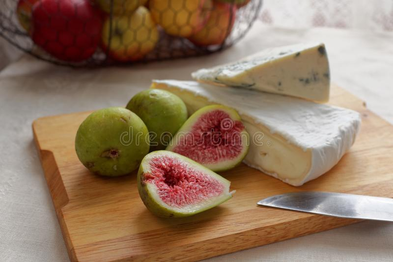 Cheeses and figs stock images