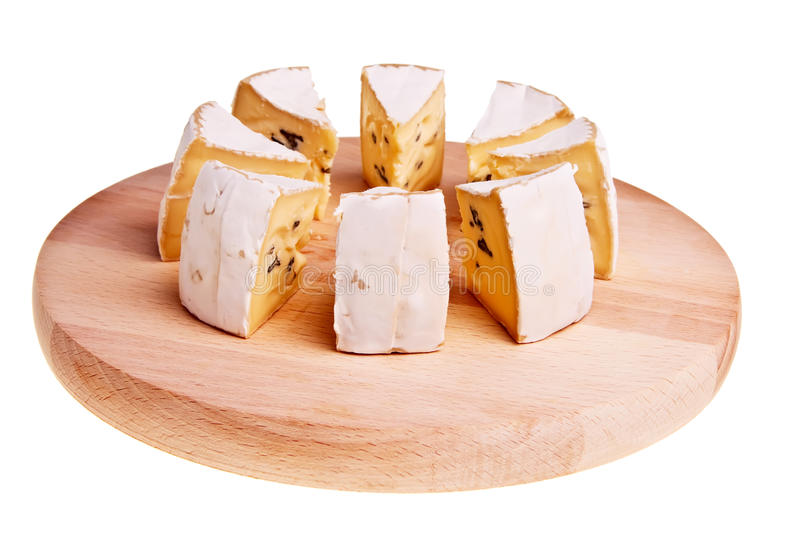 Camembert cheese cut into radial sections. Camembert cheese cut into radial sections on wooden board stock photography