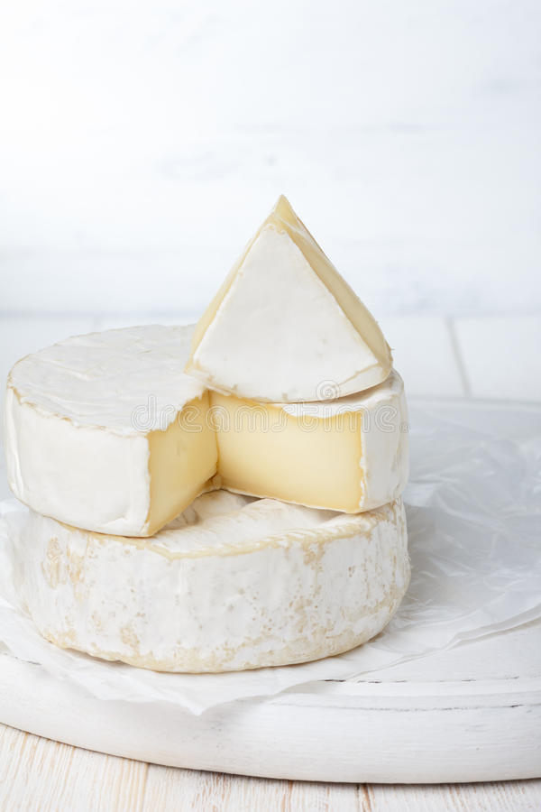 Camembert cheese. On cutting board royalty free stock photography