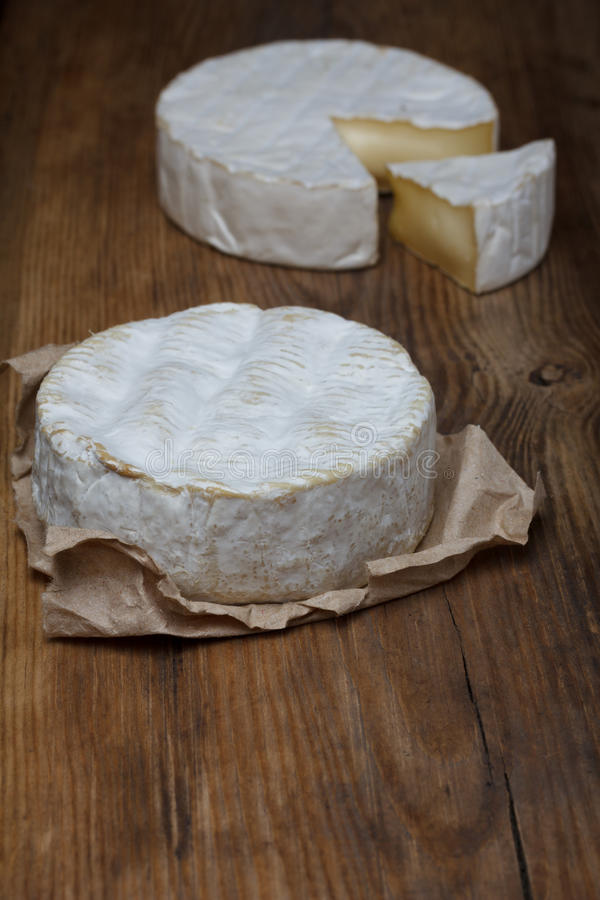 Camembert cheese. On old wooden table stock photo