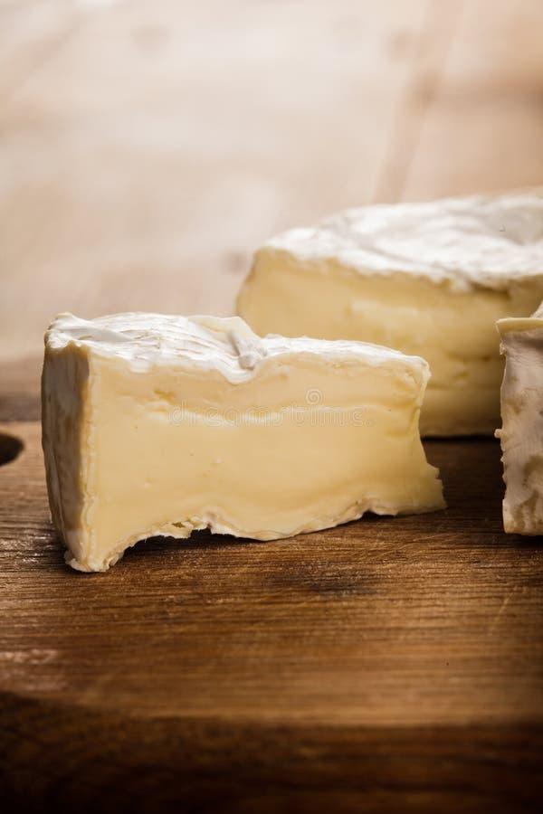 Camembert slice closeup. Camembert cheese slice macro shot. Shallow DOF royalty free stock photography