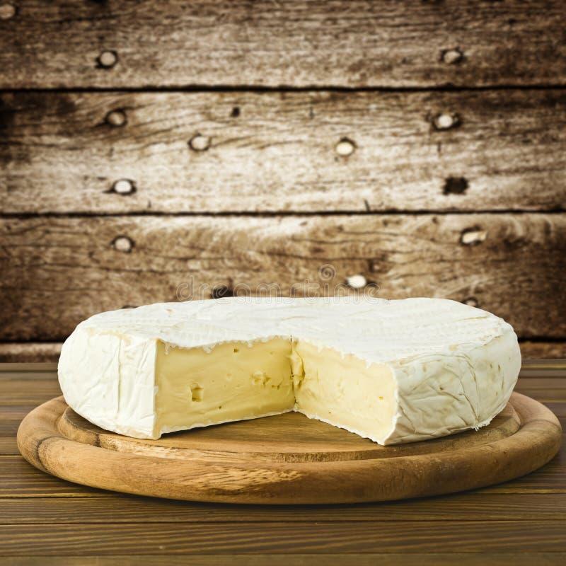 Camembert cheese. Slice macro shot. Shallow DOF royalty free stock image