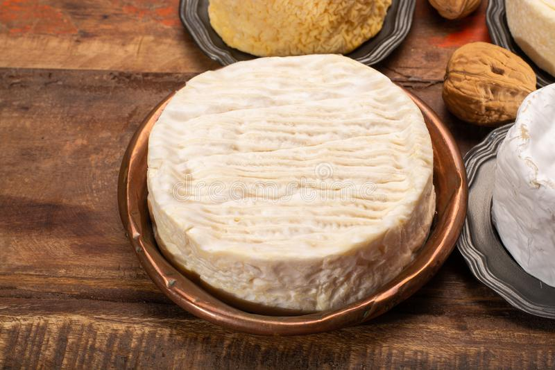 Camembert, moist, soft, creamy, surface-ripened cow's milk chees. E made in Normandy, northern France stock photography