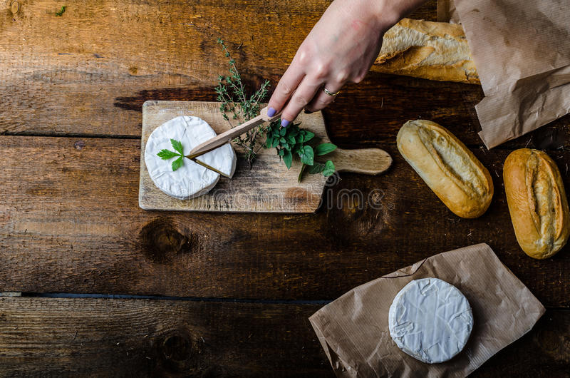 Camembert, soft cheese with homemade pastries. Old school stock image