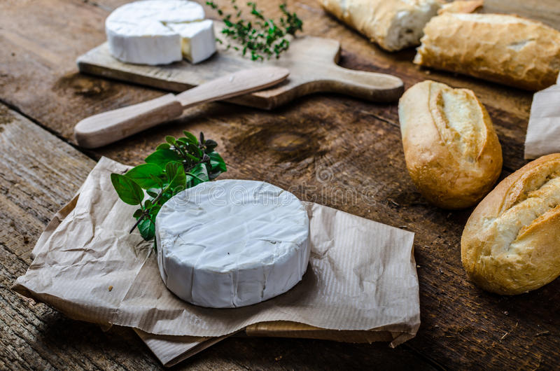 Camembert, soft cheese with homemade pastries. Old school royalty free stock images
