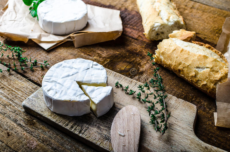 Camembert, soft cheese with homemade pastries. Old school royalty free stock photos