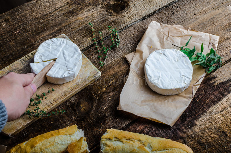 Camembert, soft cheese with homemade pastries. Old school royalty free stock image