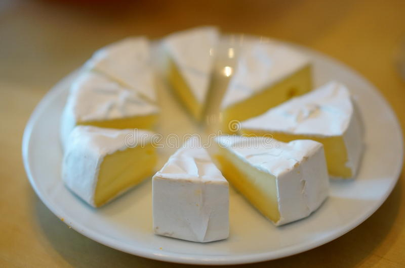 Camenbert cheese. On plate royalty free stock image