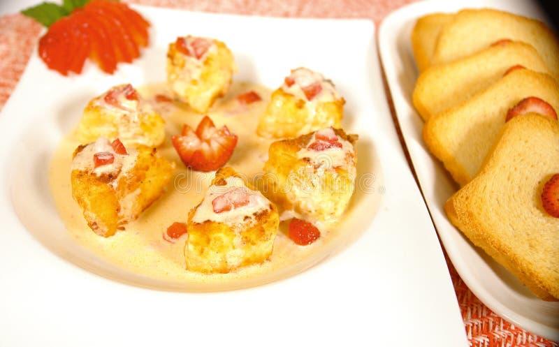 Camenbert starter. Starter with camenbert cheese and strawberry sauce stock photo