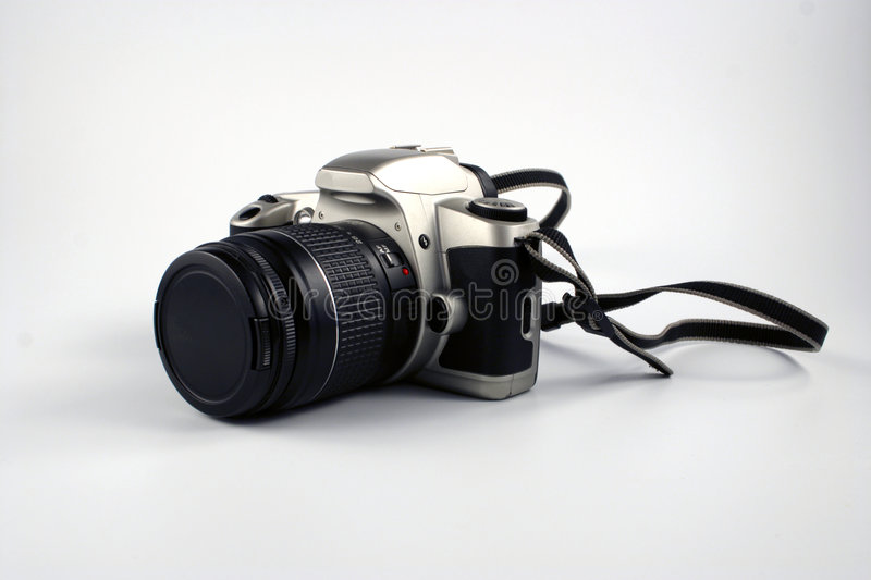 Camera. Unbranded 35 mm camera on white back ground stock photos