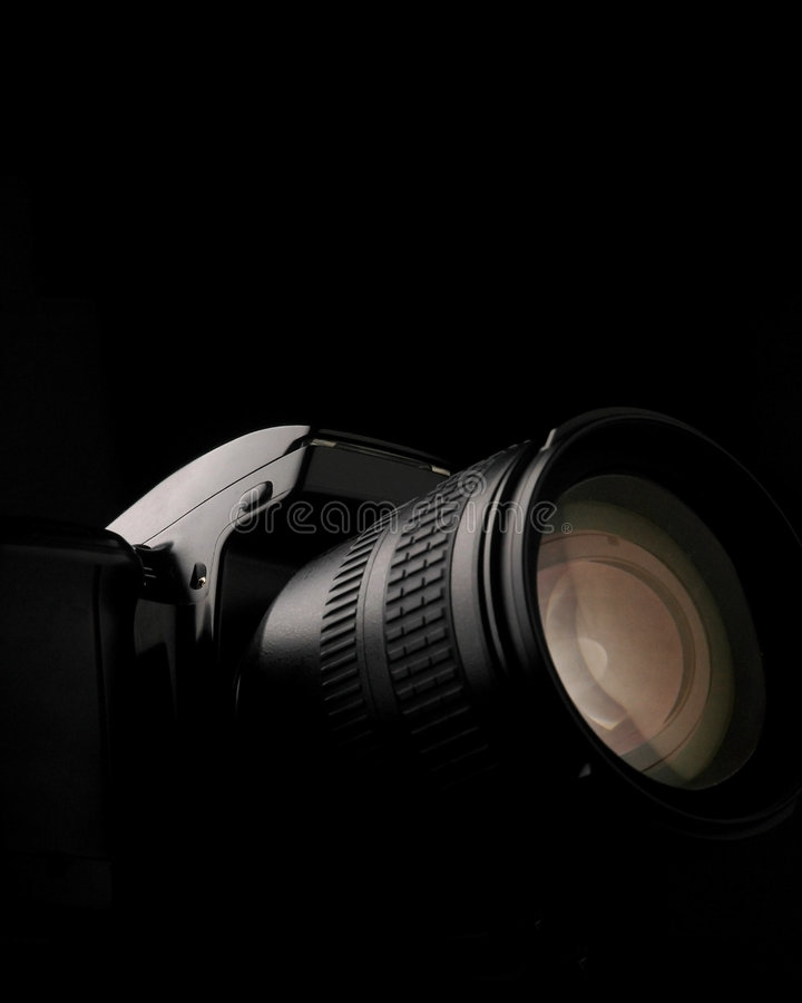 Camera. Bw camera dslr with one lighting with black background royalty free stock photos