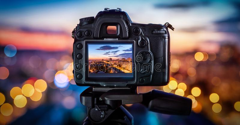 The camera on the background blurry city lights. The camera on the background blurry city night lights royalty free stock photos