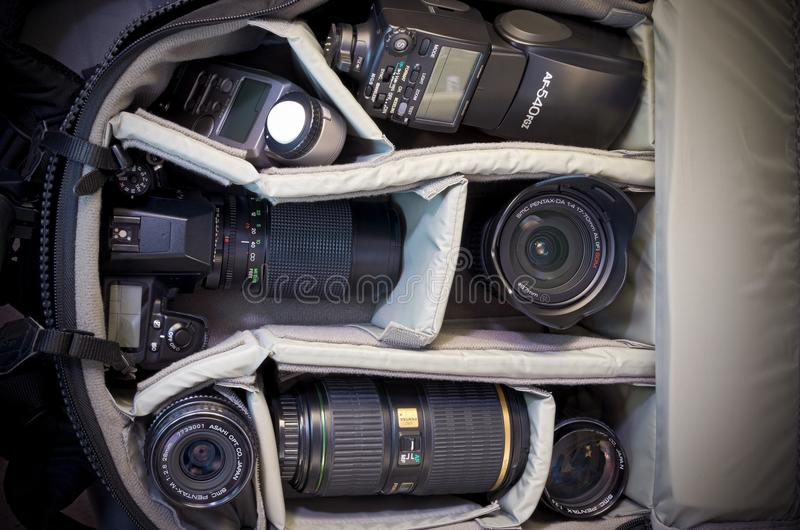 Camera Bag and Photo Equipment. West St. Paul, Minnesota, USA – APRIL 14, 2018: Camera bag packed with gear including Pentax-brand camera body royalty free stock images