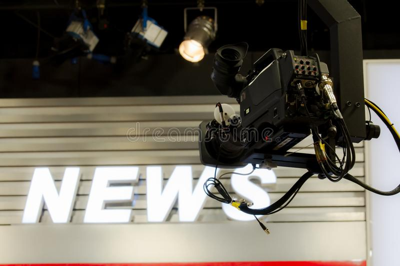 Camera in broadcast news room. stock photos