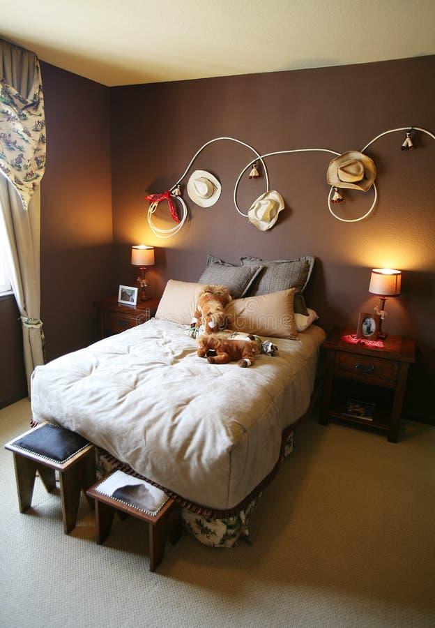 Camera da letto del rodeo del cowboy immagini stock