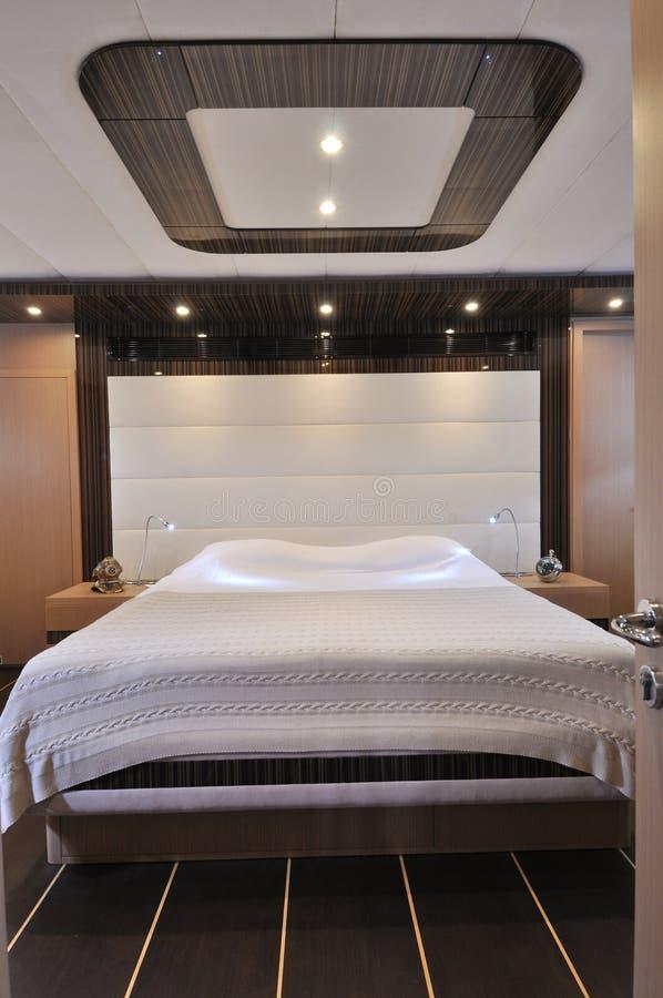 Camera da letto della barca a vela fotografia stock for Disegni della camera da letto della spiaggia
