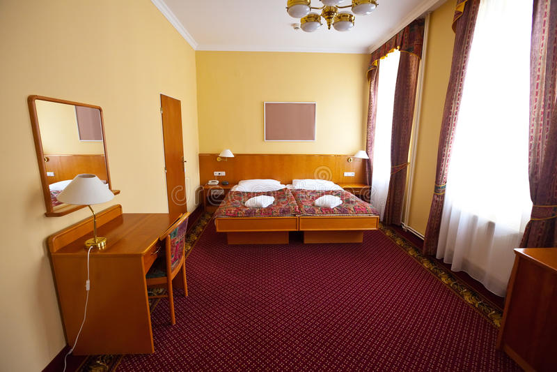 Camera da letto della serie dell'albergo di lusso immagine stock libera da diritti