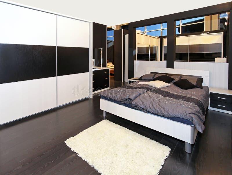 Camera da letto grigia immagine stock