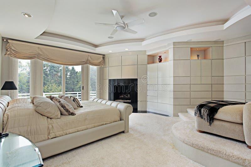 Camera da letto matrice con zona di seduta elevata immagine stock