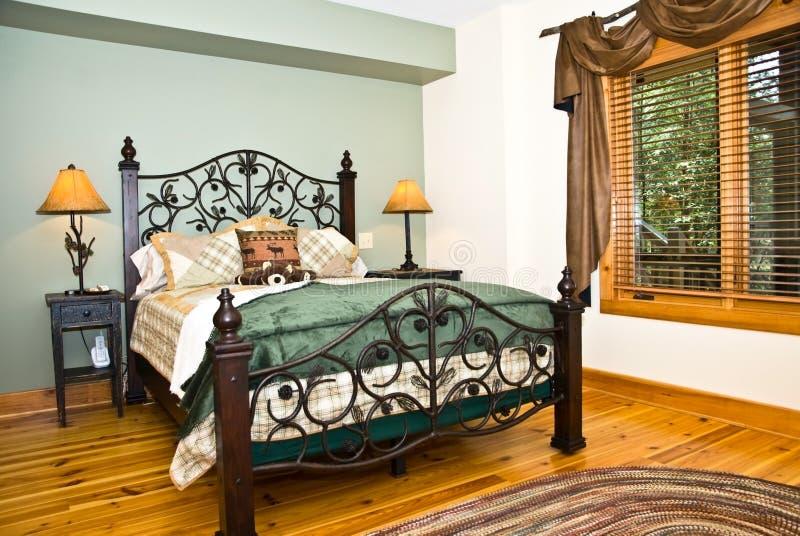 Camera da letto moderna/decorazione rustica fotografia stock
