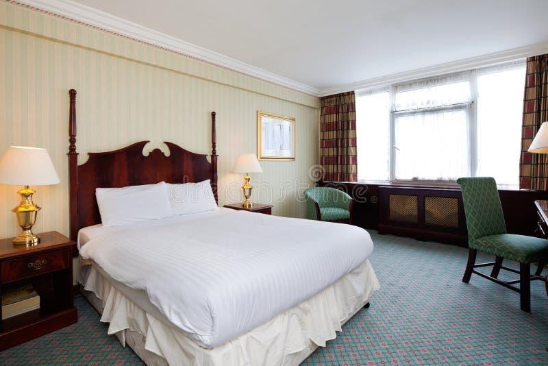 Camera di albergo semplice fotografie stock
