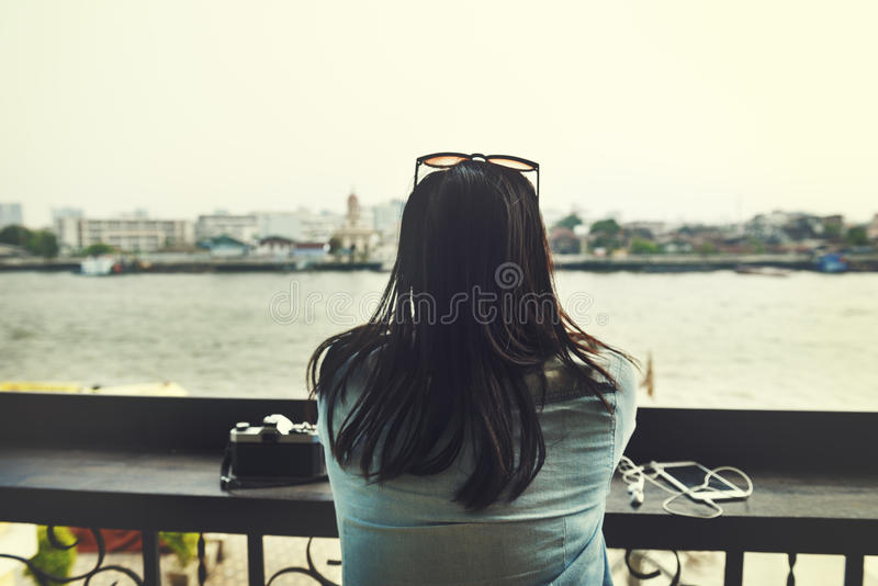 Camera Digital Device Earphones Girl River Jeans Concept royalty free stock photo